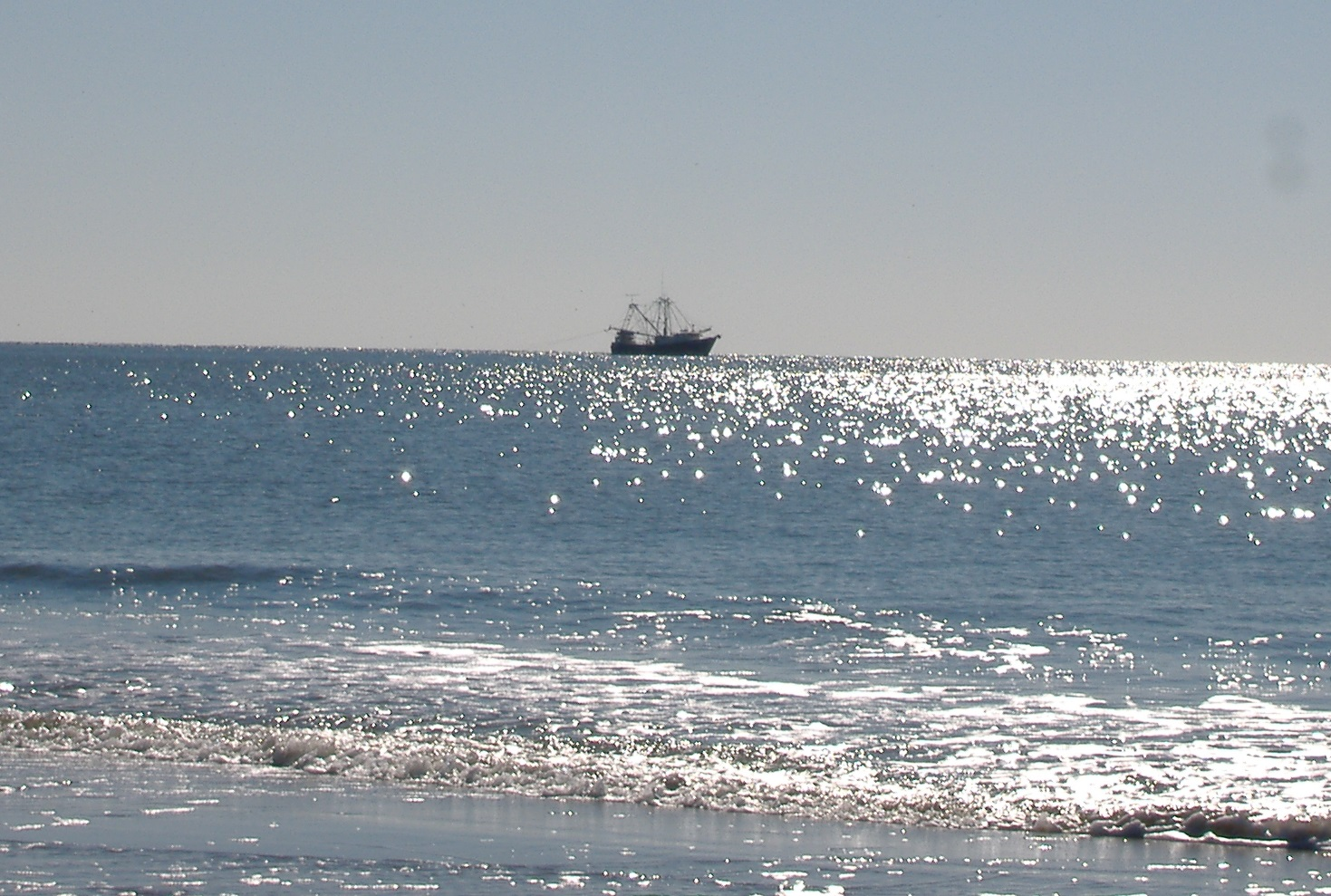 boat on the ocean at Oak Island NC pictures