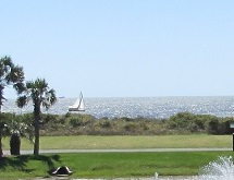 golf course ocean sailboat Oak Island Caswell Beach NC