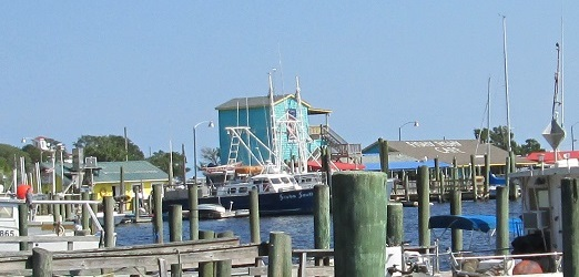 shops dining and boats at the Old Yacht Basin area in Southport NC