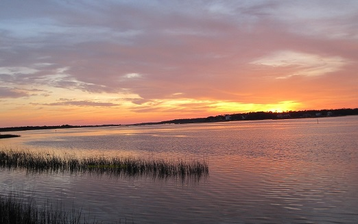sunset over the Lockwood Folly River Sunset Harbor NC area